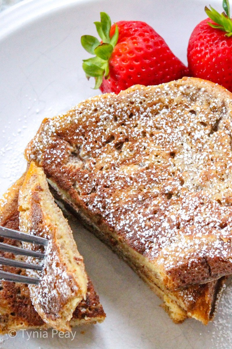 Brioche French toast plated with a fork