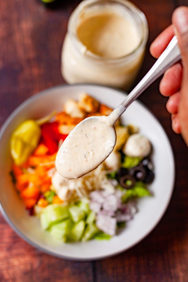 creamy italian dressing on a spoon