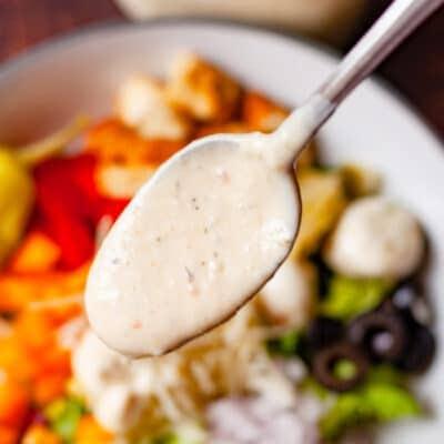 creamy italian dressing on a spoon close up