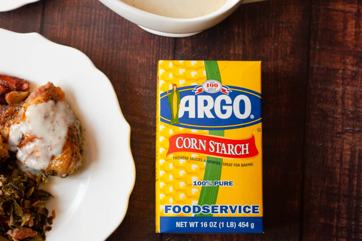 argo corn starch next to a plate of of chicken and gravy