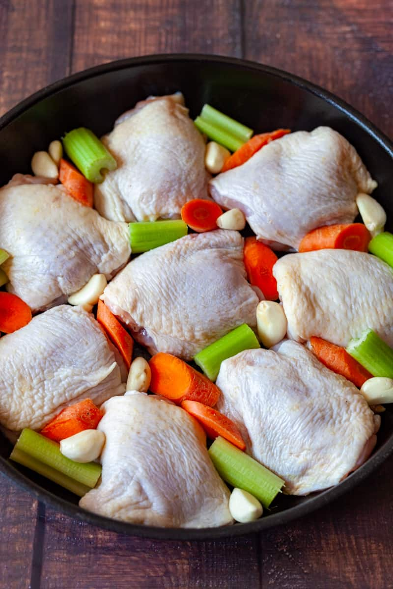 preparing chicken thighs with celery and carrots