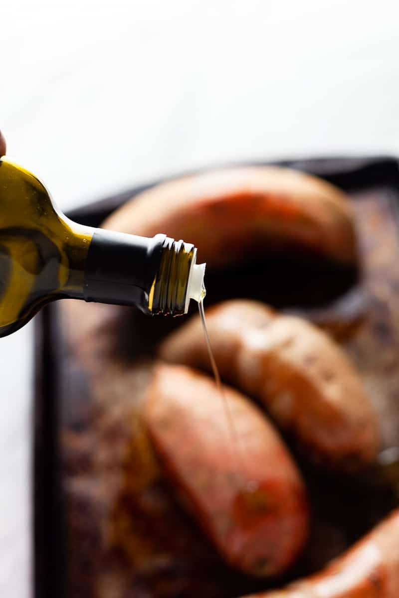 oilve oil poured on sweet potatoes