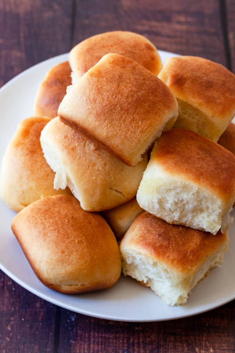 platter full of dinner rolls