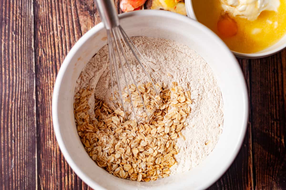 flour and oats in a bowl cose up