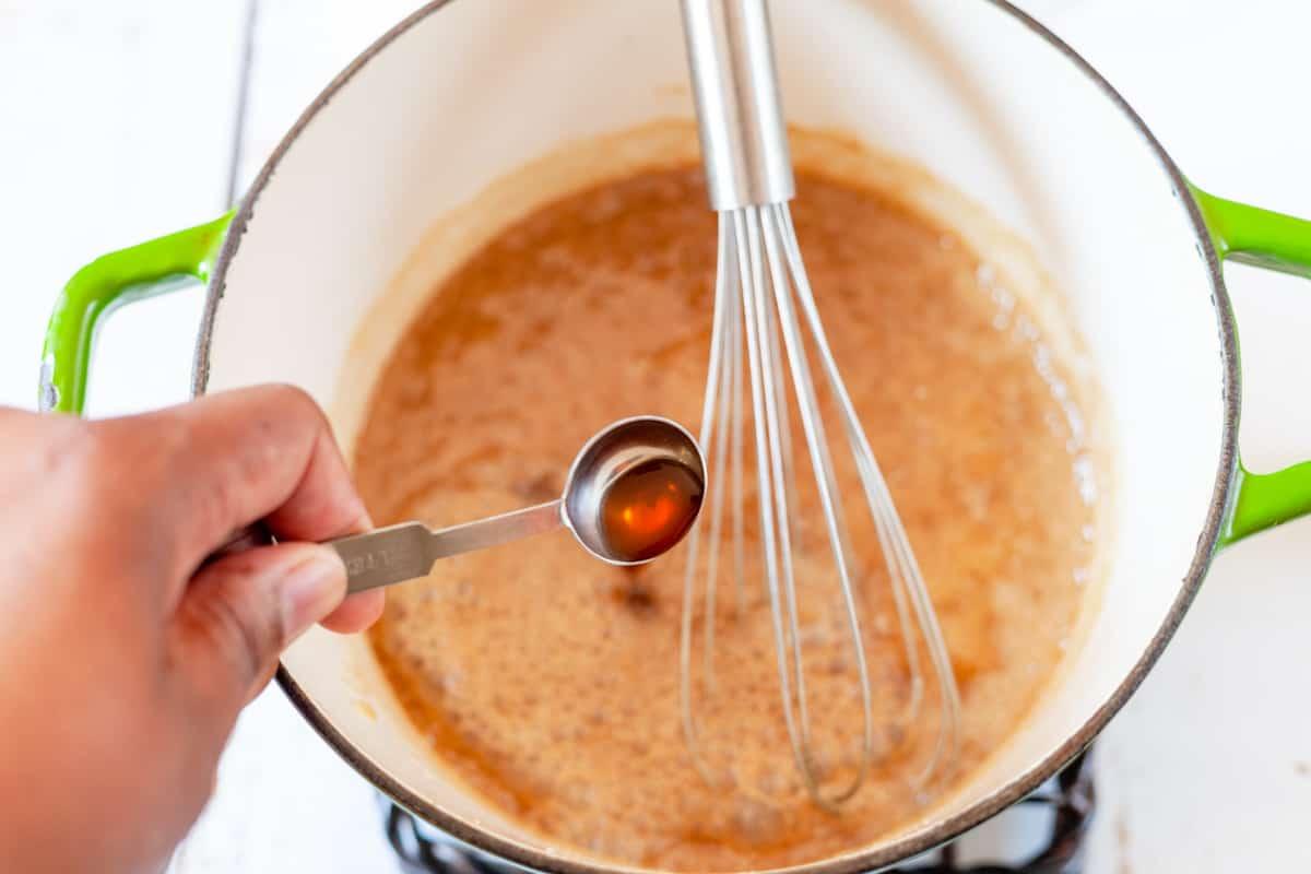 pouring vanilla into caramel