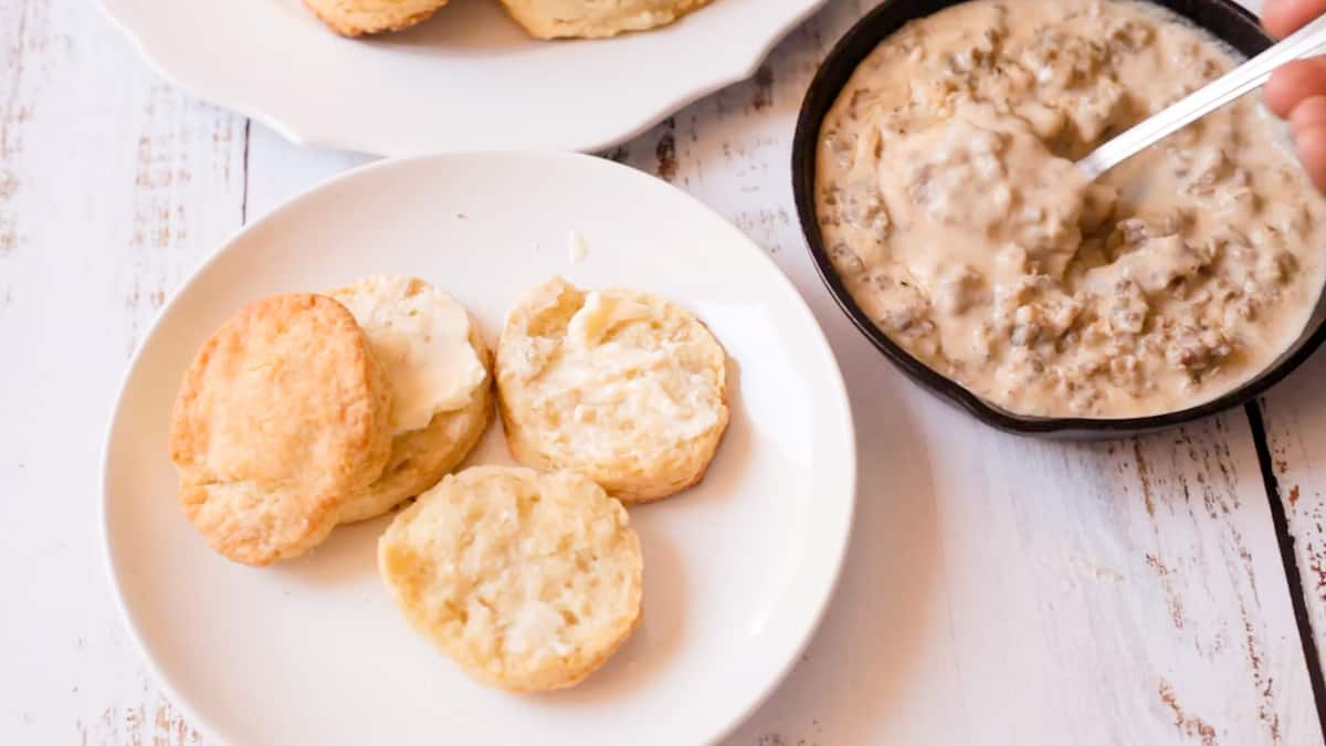 flaky biscuits next to southern sausage gravy