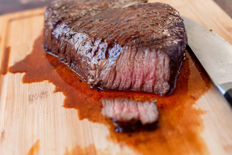 top round roast on a cutting board