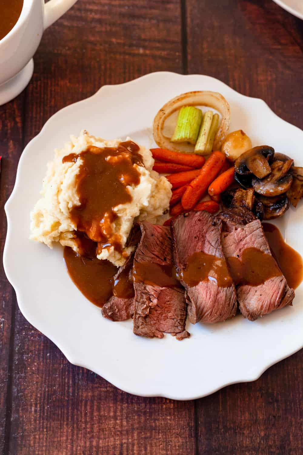 brown gravy over potatoes and london broil roast