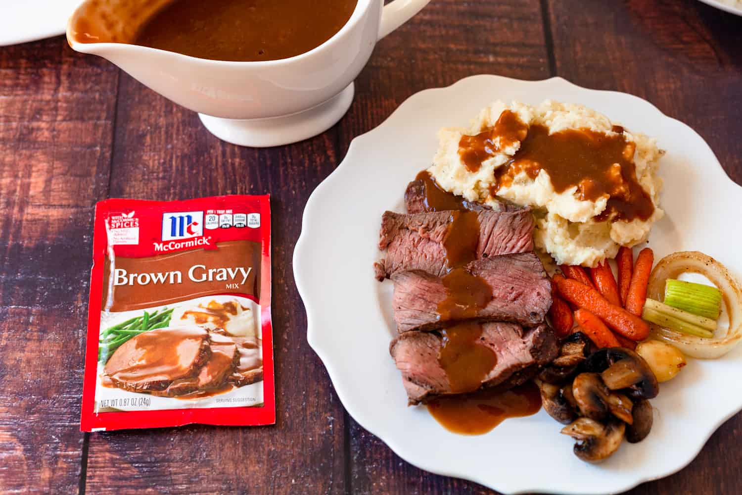 brown gravy over potatoes and roast