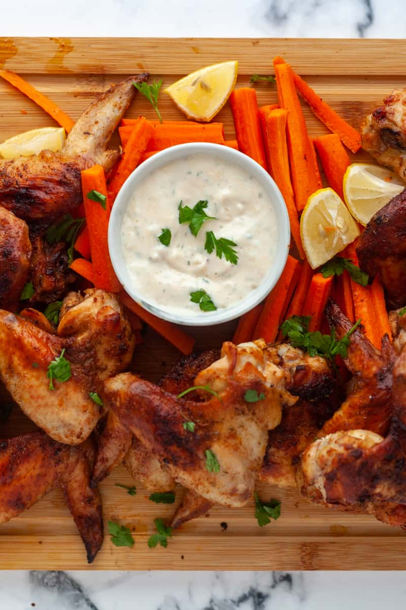 wings and dip with carrot and lemons