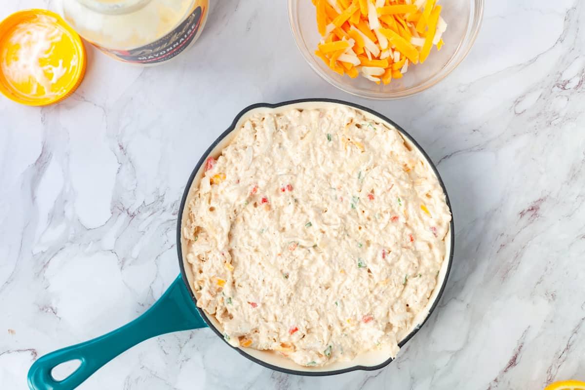 crab dip in a pan before baking