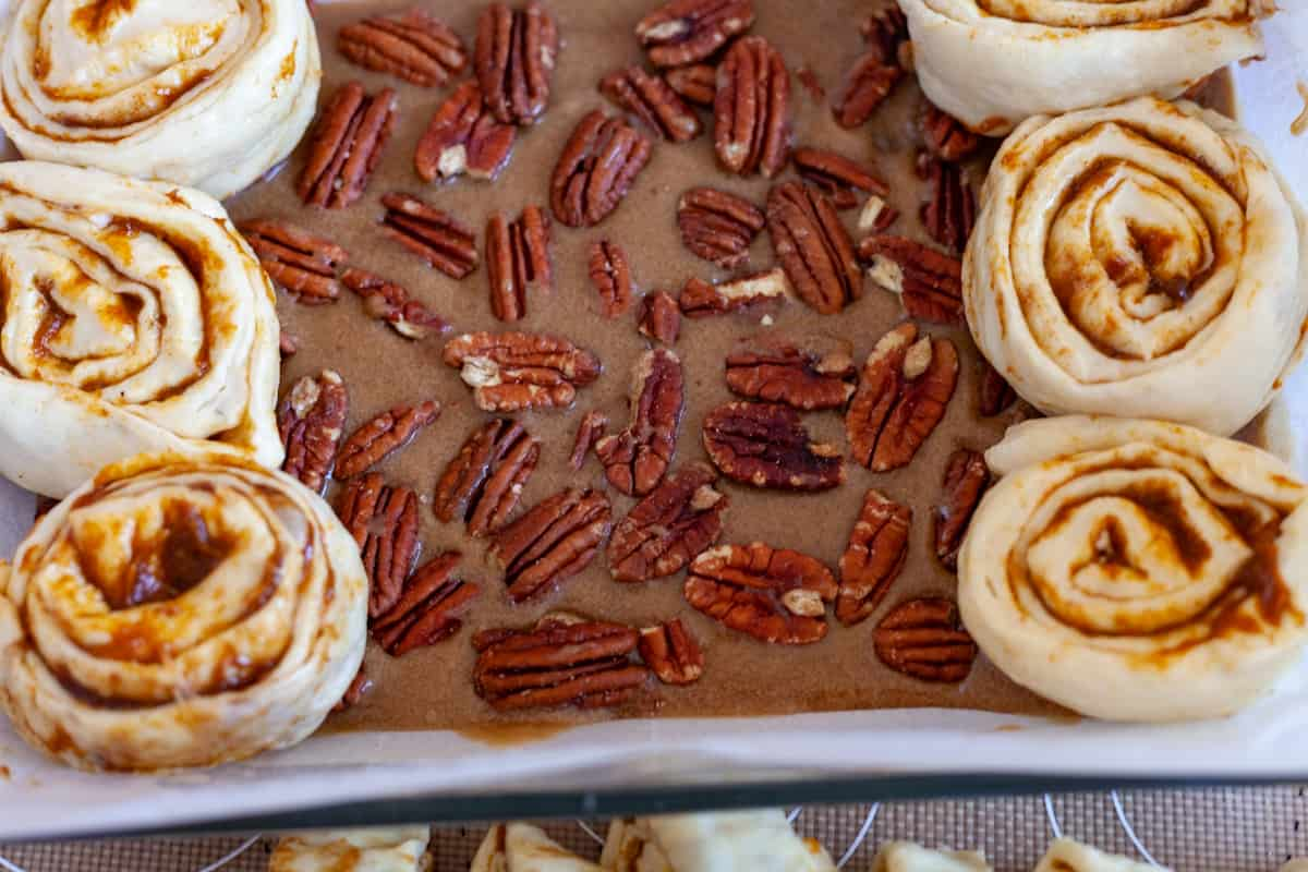 pecan sticky topping and sweet rolls in a pan