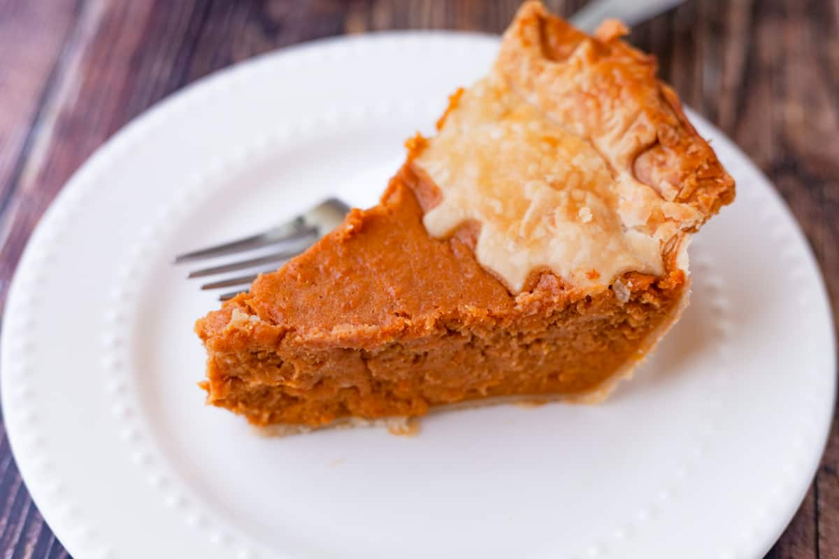 a slice of sweet potato pie on a plate