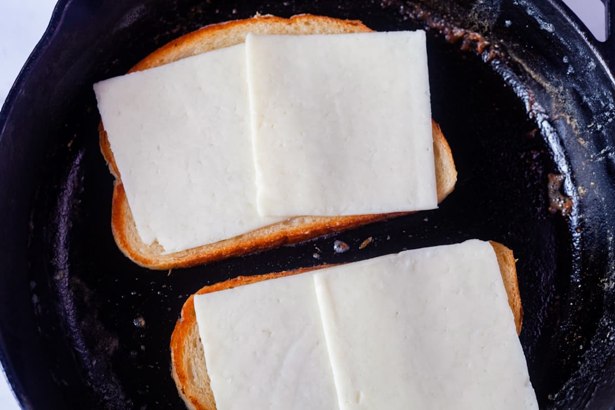 melting provolone cheese on bread