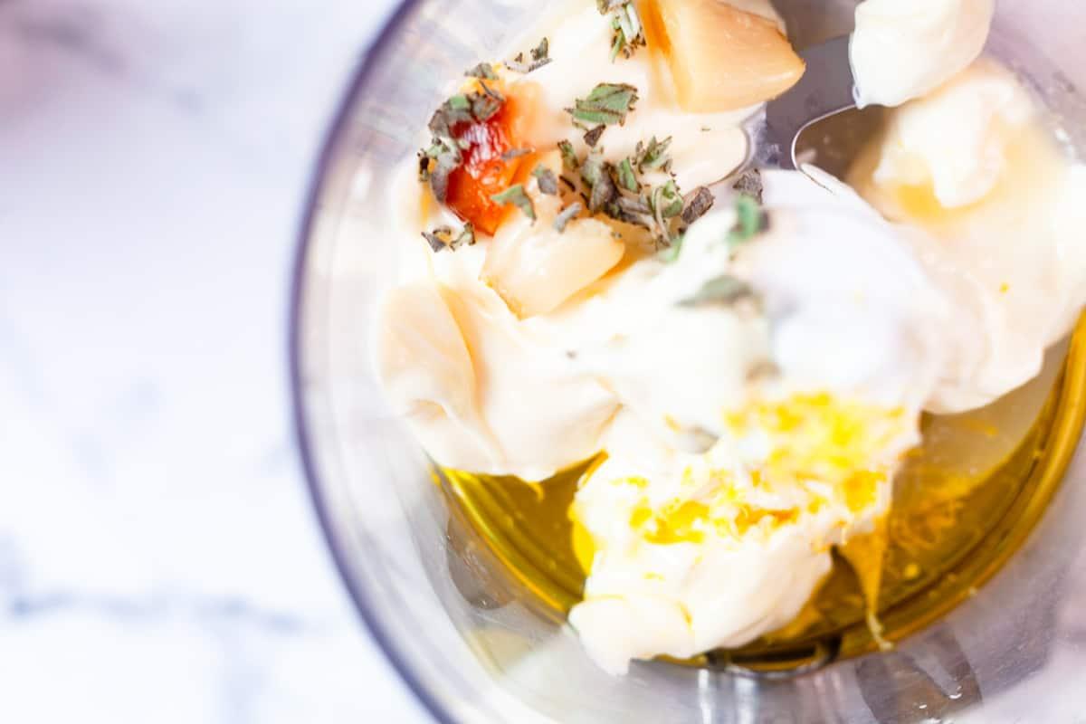 sage mayo ingredients in a blender cup