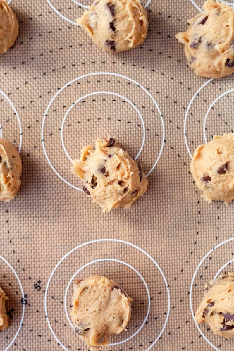 cookie dough on a baking mat