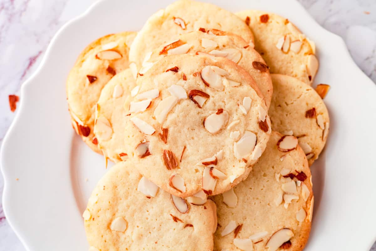 almond sugar cookies on a white plate