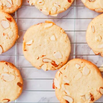 almond sugar cookies on a cooling rack