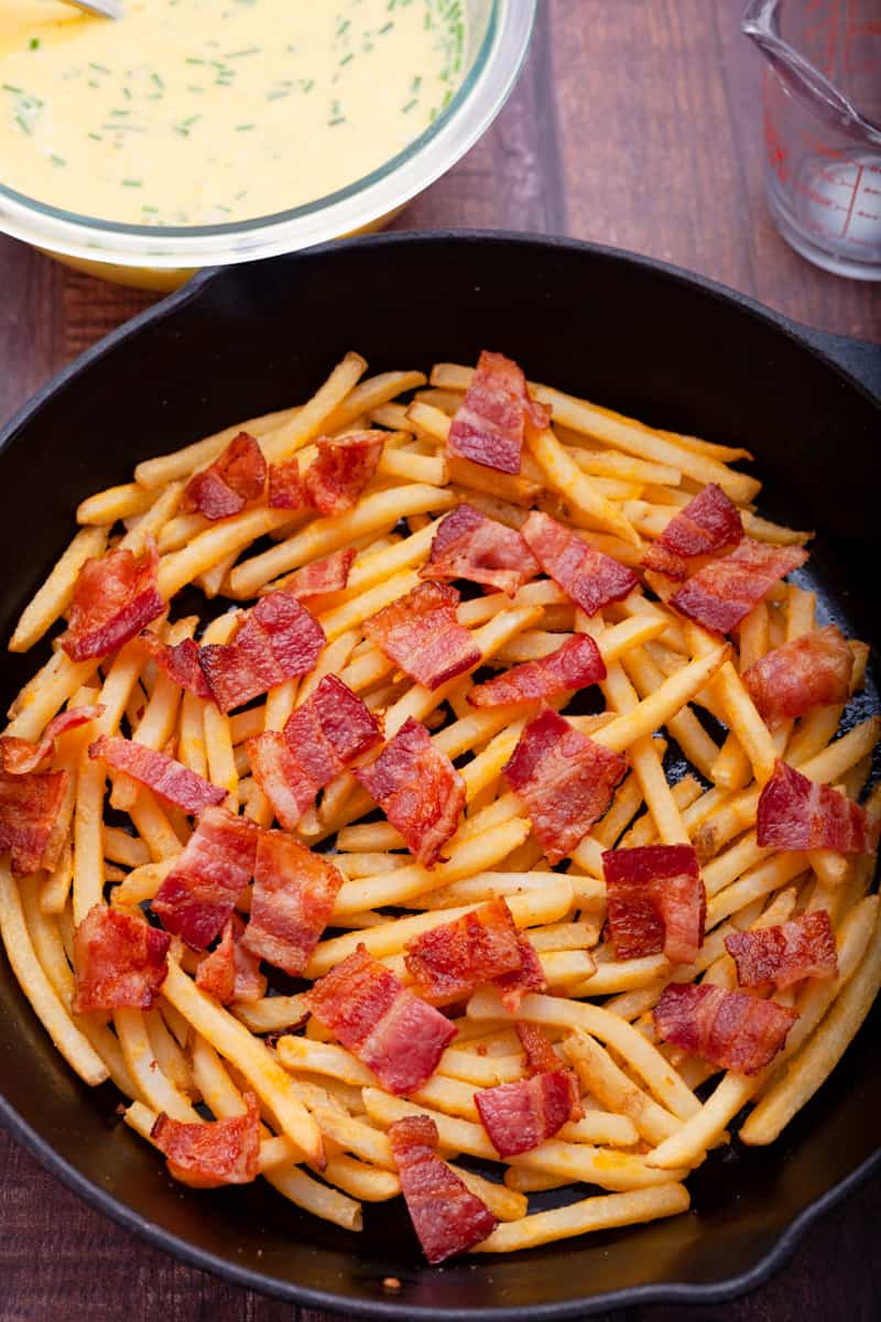 french fries topped with bacon