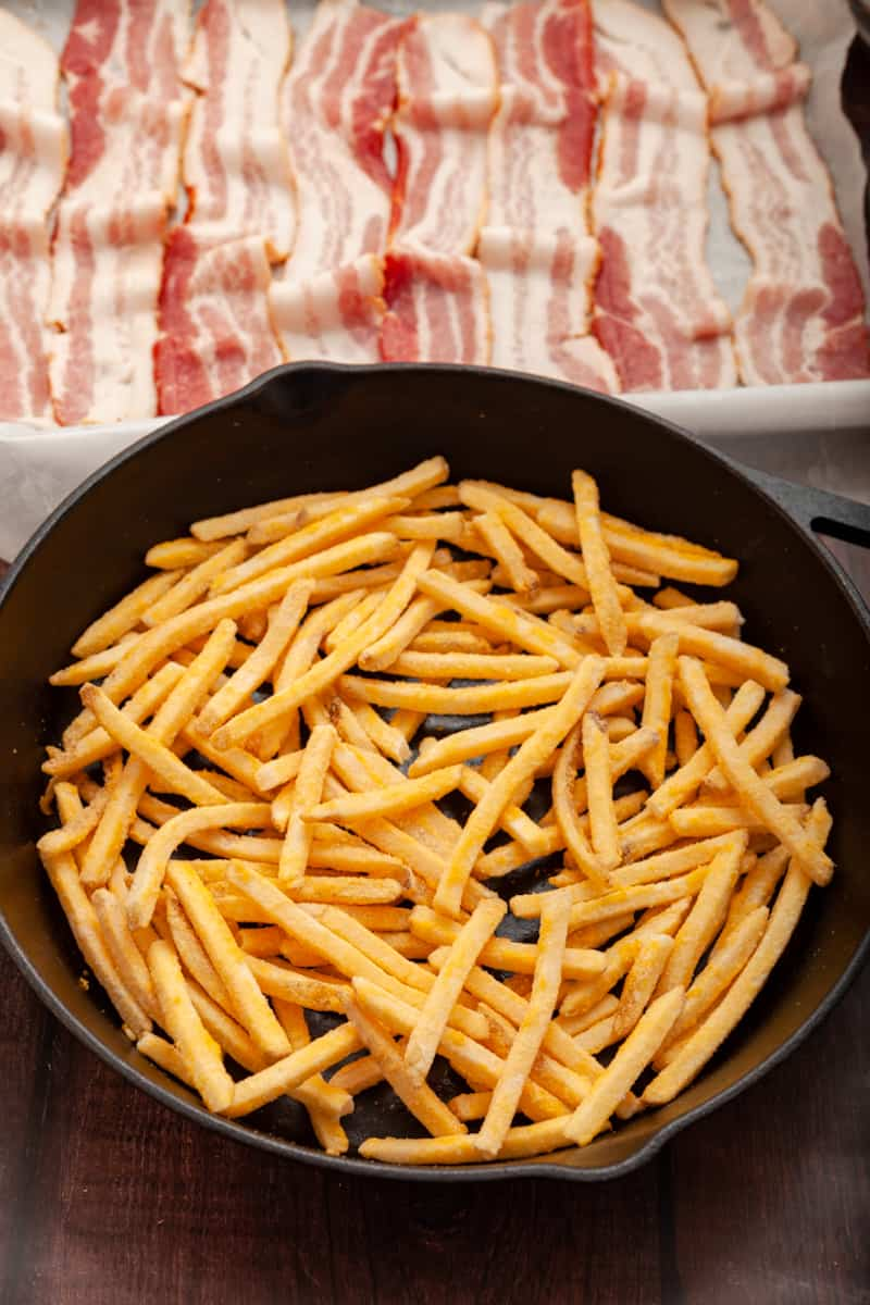 shoestring fries in a cast-iron skillet