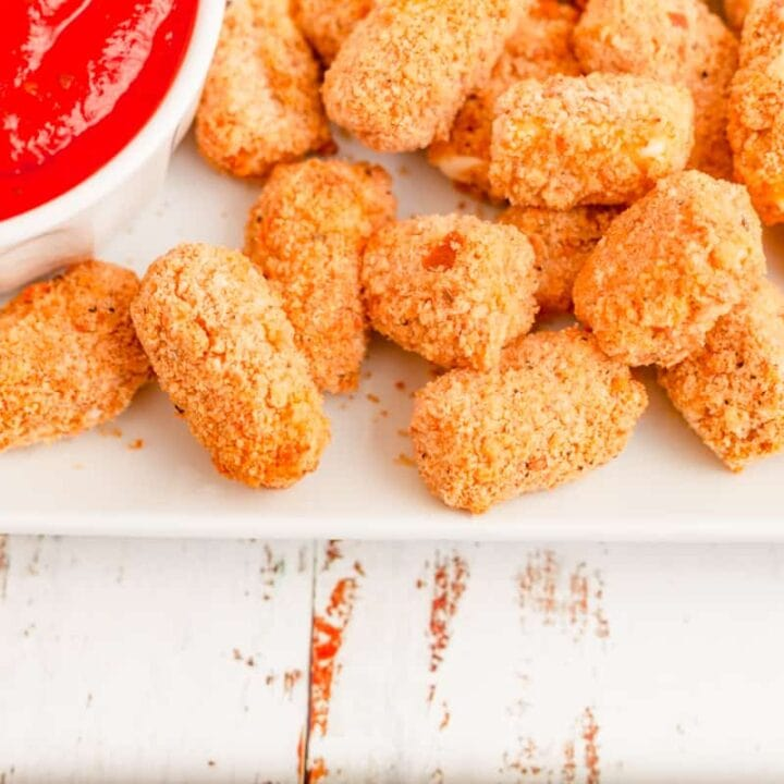 plated air fried mozzarella bites with marinara sauce