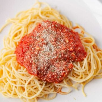 pasta topped with marinara and spices