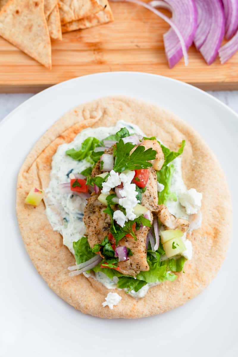 chicken gyro with tzatziki sauce, salsa, and feta
