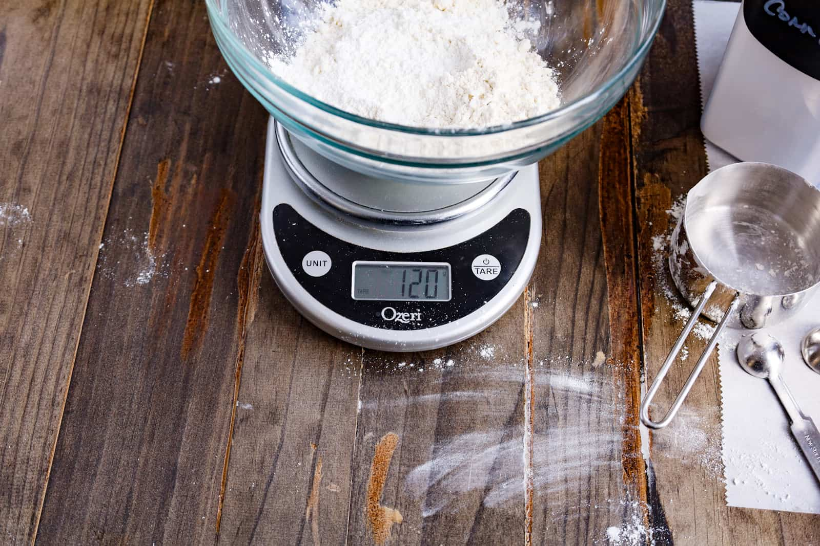 weighing flour on a kitchen scale