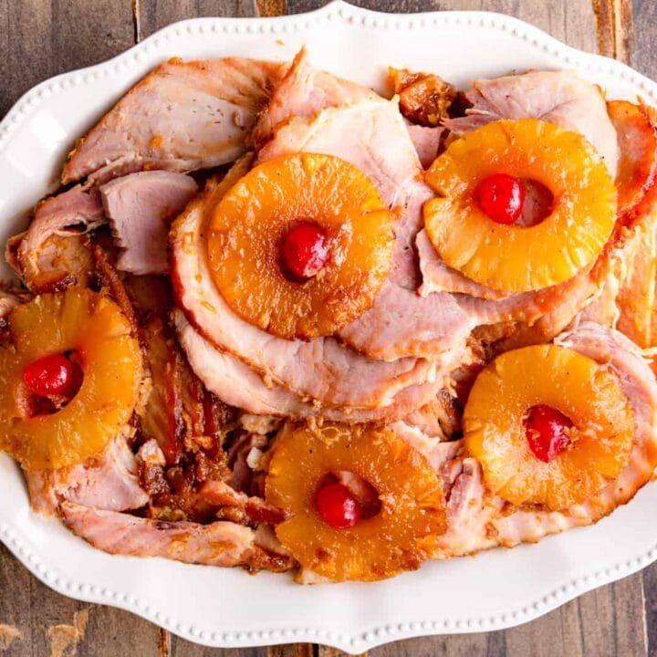 ham sliced with pineapple rings on a platter