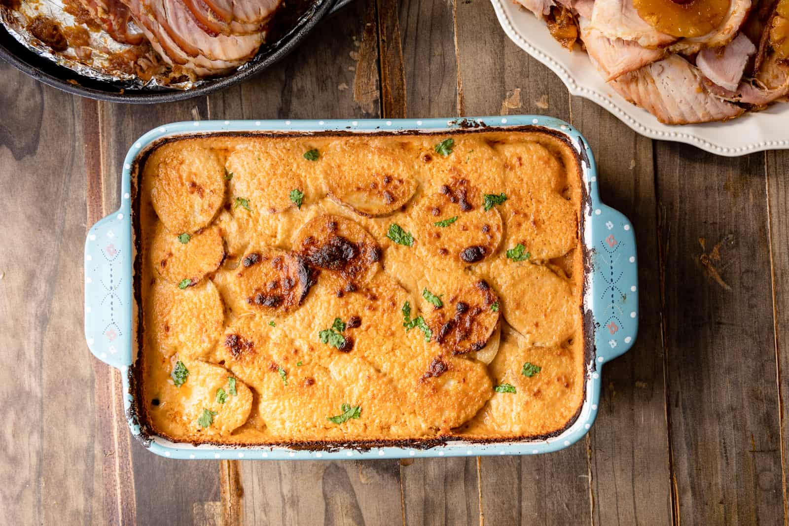 cheesy scalloped potatoes in a baking dish