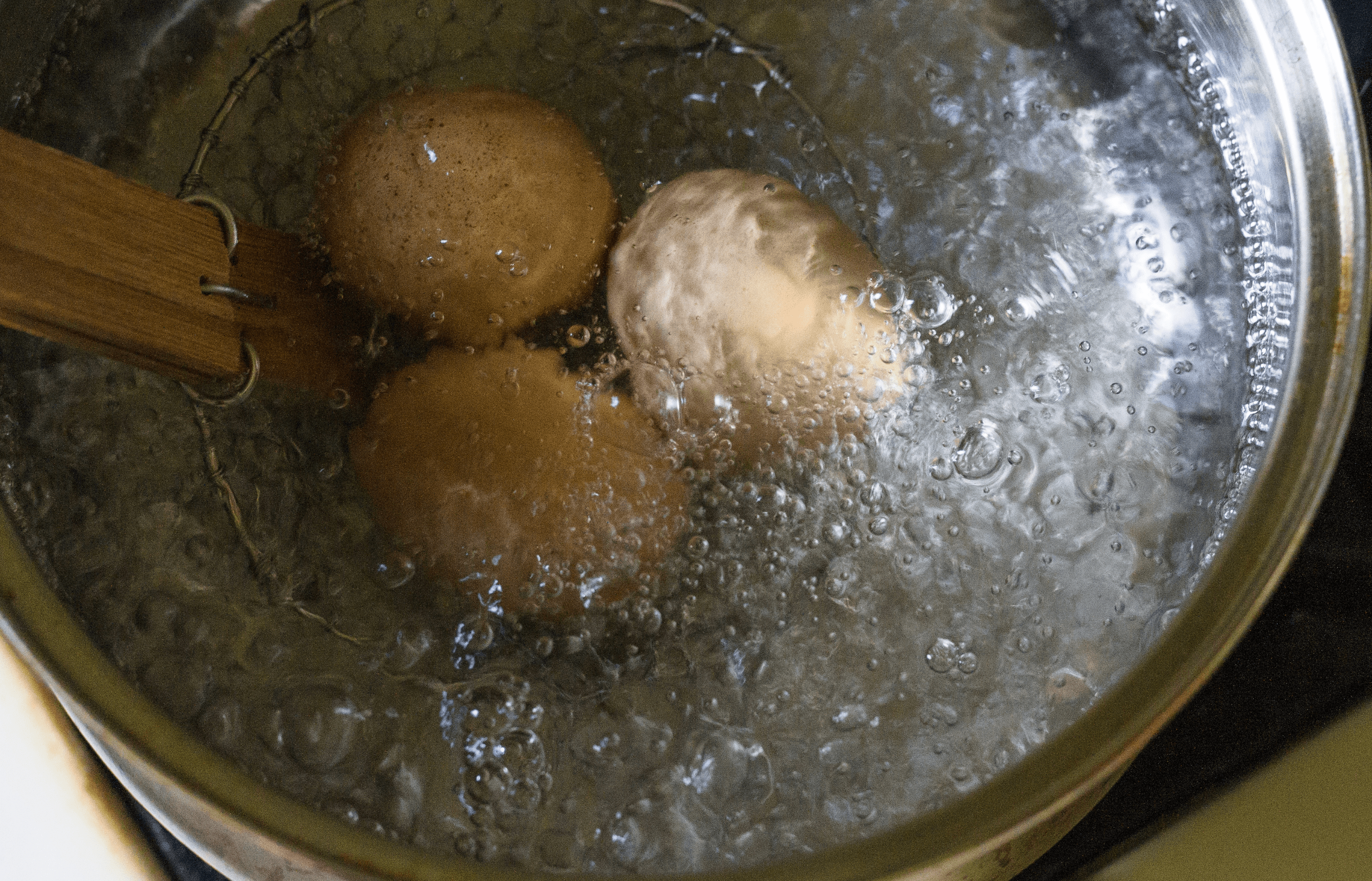 placing eggs in boiling water