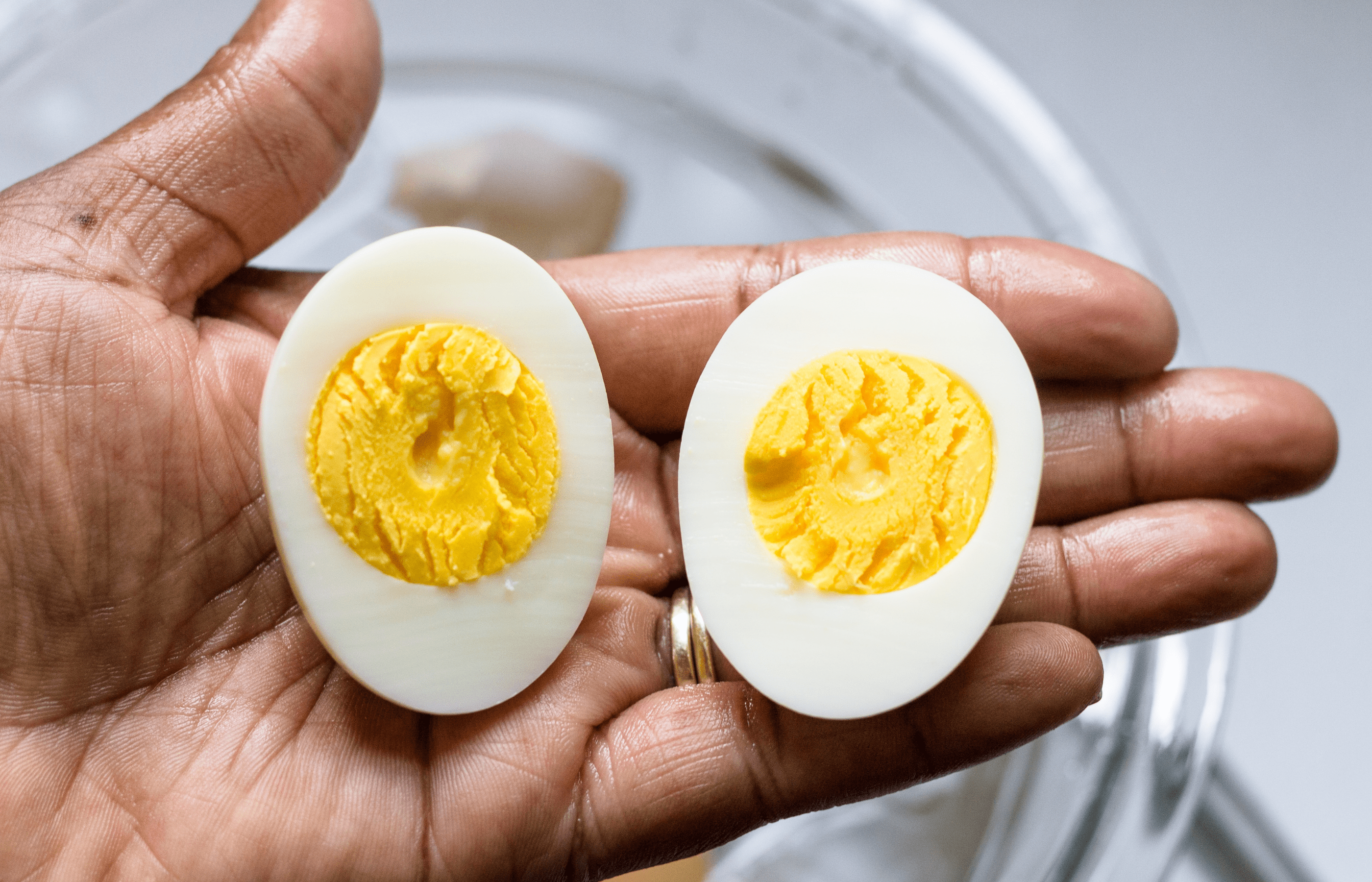 holding a sliced perfectly boiled egg